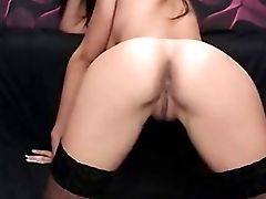Hot Black-haired In Fishnets Massages Her Taut Vagina